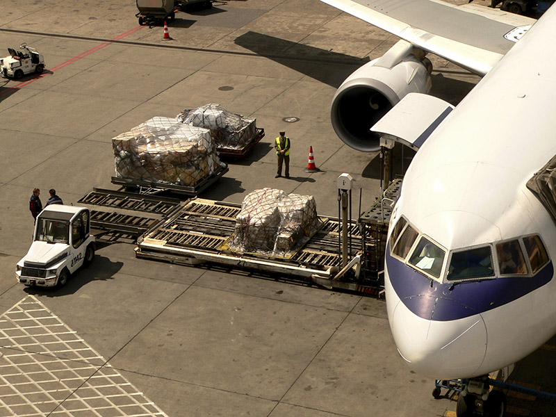 freight being loaded on to airplane