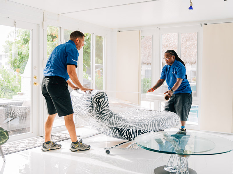 miami home movers wrapping expensive furniture