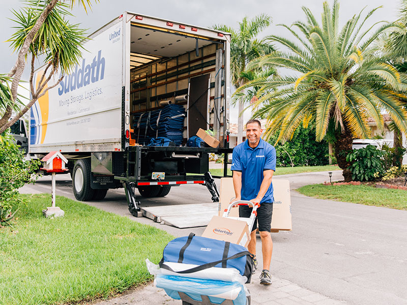 miami local mover pushing dolly with moving supplies