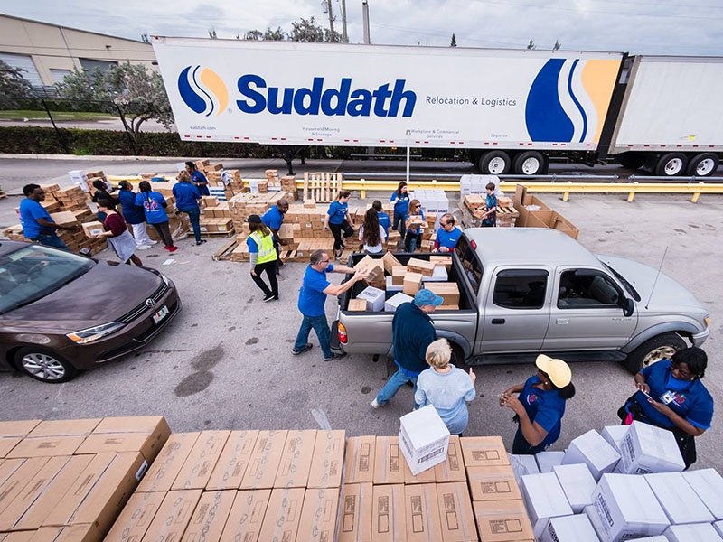 suddath employees loading boxes onto vehicles