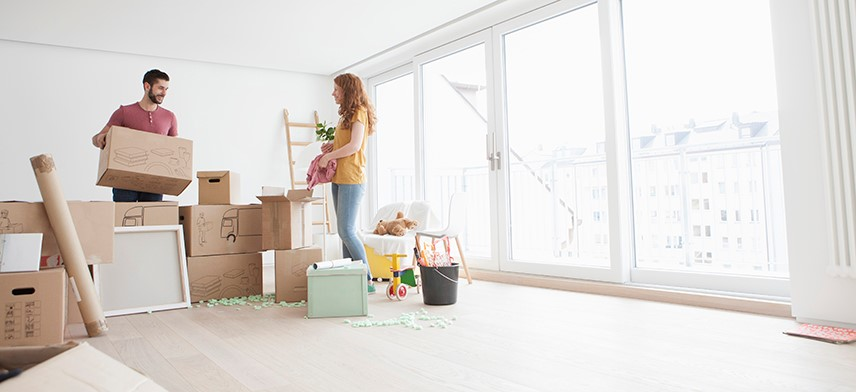 couple with moving boxes during first move