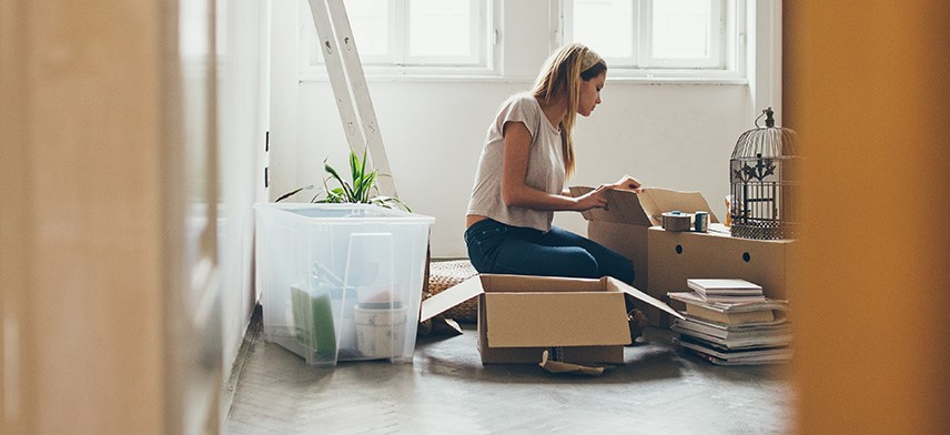 woman packing items for move