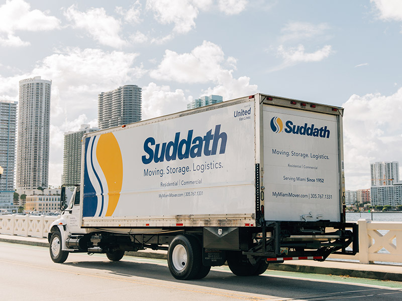suddath moving truck driving in miami florida