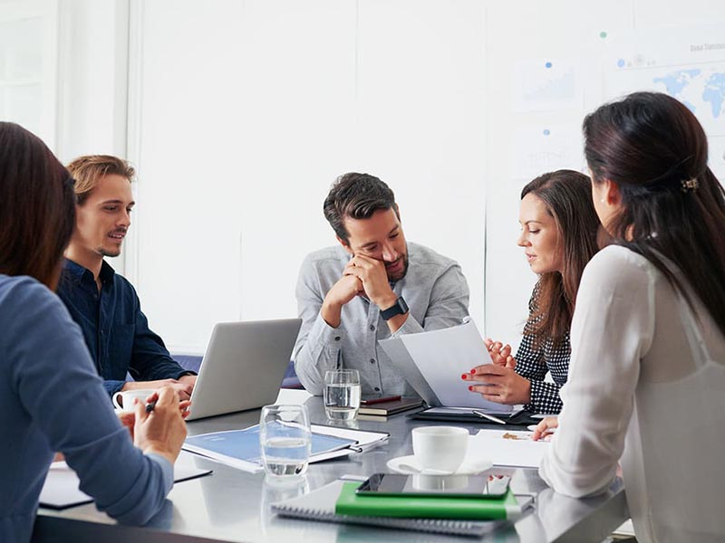 group discussing office move planning in conference room