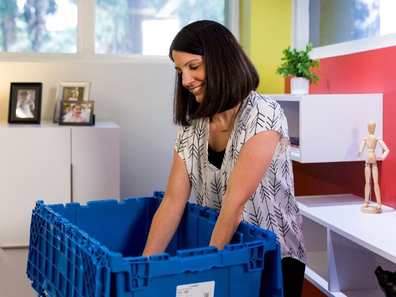 employee packing items for office move