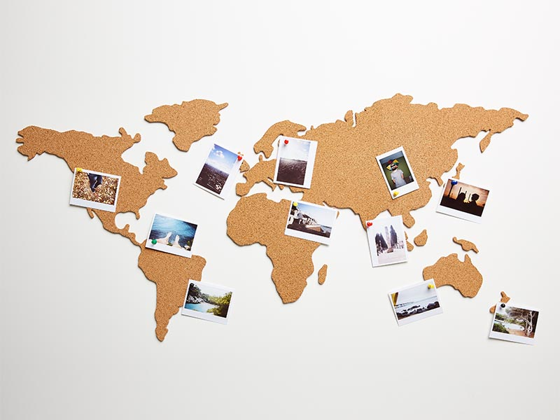 international map with photos on wall