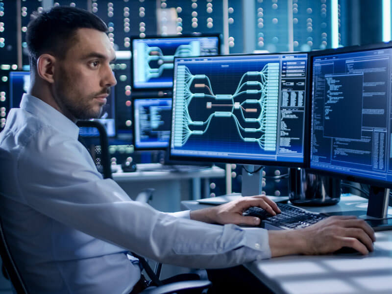man monitoring global compliance security on monitors