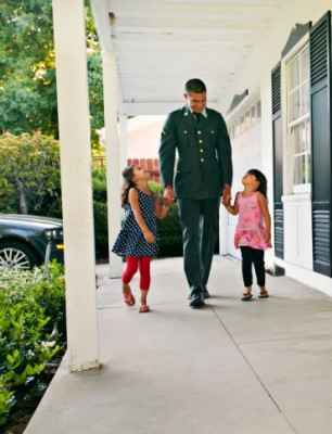 military dad walking with daughters