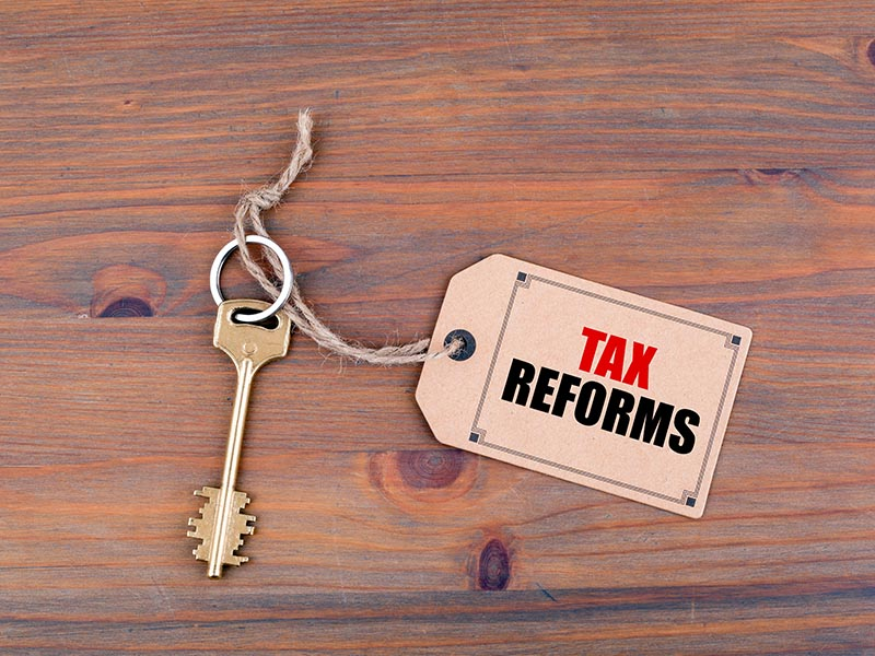 key with tax reform tag