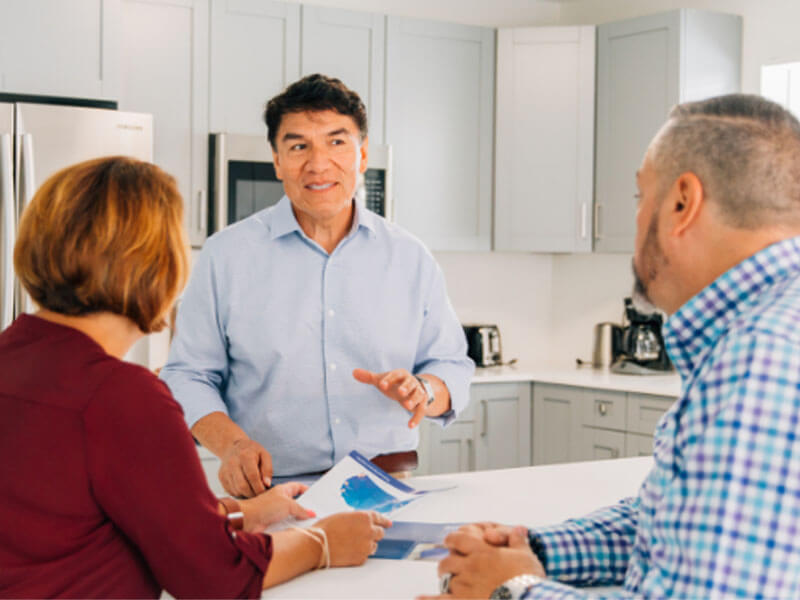 realtor discussing questions couple has about home moving